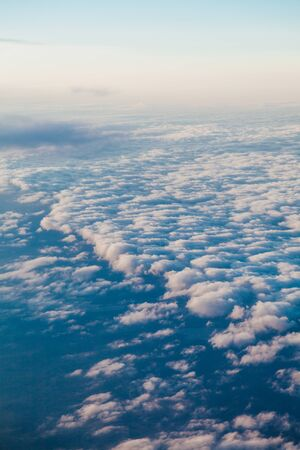 the sky above the clouds from aircraft iljuminatora at sunset Reklamní fotografie