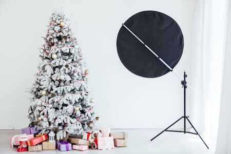 PhotoStudio Christmas tree in the room with gifts new year Stock fotó
