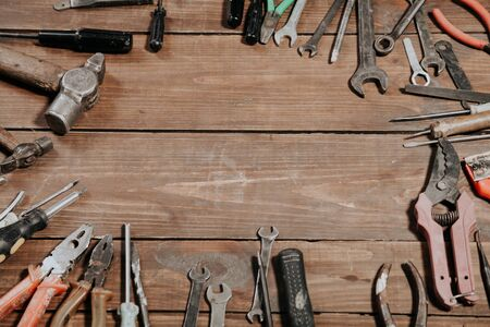 construction hammers screwdriver repair tool pliers on the boards