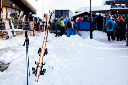 Alpine skis and Snowboards at snow ski resort vacation