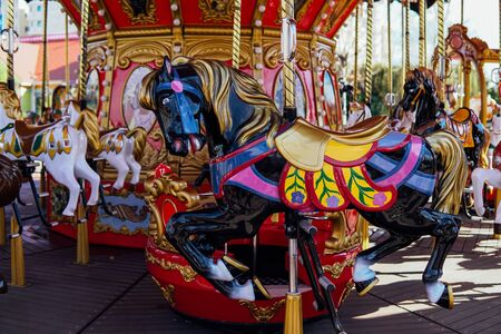 Carousel for children with horses attractions