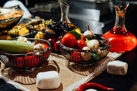 fresh vegetables in the kitchen of the restaurant with spices