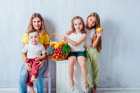 children sit with fresh vegetables healthy eating fruit Фото со стока