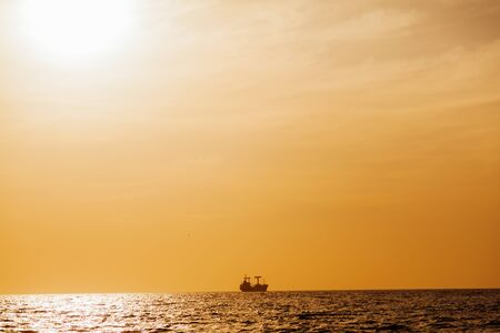 Sunset landscape ocean sea and ship on the horizon 1