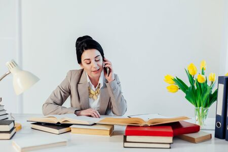 teacher business Lady reads books in the Office