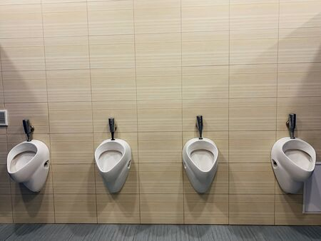 white toilets in the public mens 版權商用圖片