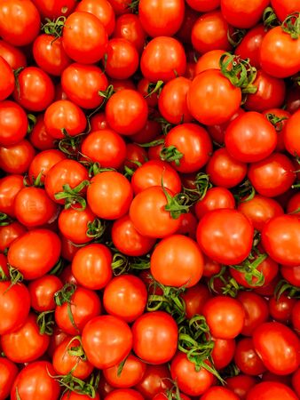 red ripe tomato for eating like a background