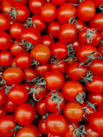 lots of red ripe tomato for eating like a background