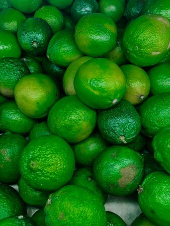 lots of green ripe lime citrus for eating like a background