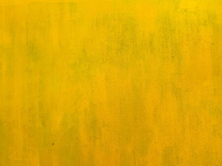 old yellow vintage loft wall structure paint as background