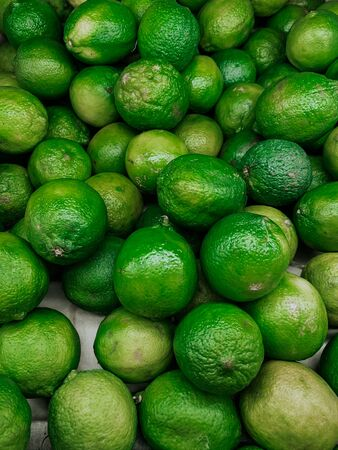 green sour limes to eat as a background