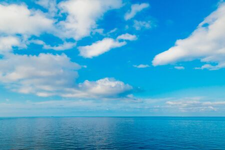 Open blue sea horizon and sky with clouds 版權商用圖片