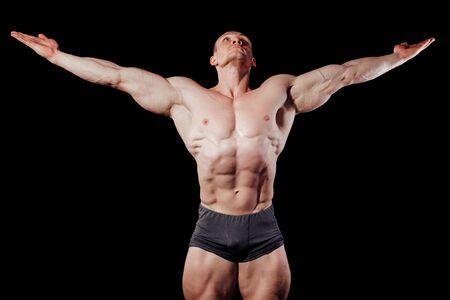 man bodybuilder sportsmen muscular biceps fitness