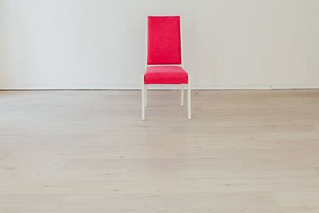 pink chair in the interior of an empty room