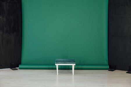 one chair in the interior of the room with a green background 版權商用圖片