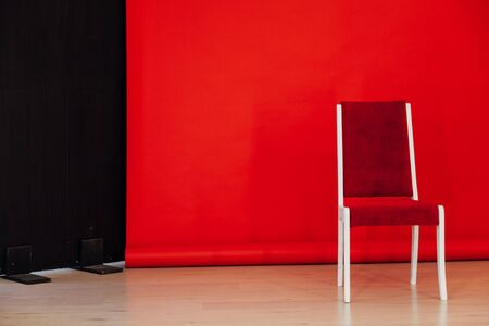 one chair in the interior of the room with a red background 版權商用圖片