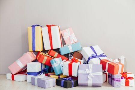 multi-colored gifts on a gray background