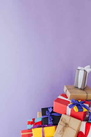 lots of colorful Christmas birthday gifts new year purple background