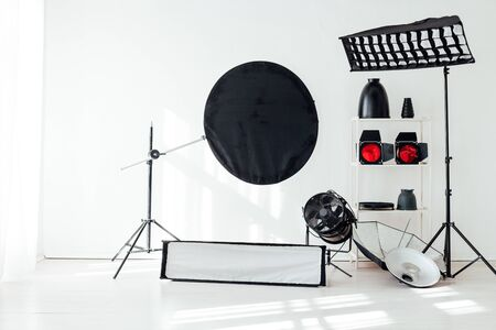 Photo studio accessories flashes white background