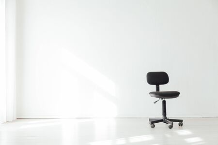 black office chair in an empty office