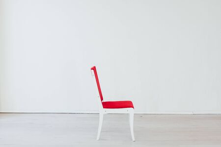 red chair in the interior of an empty white office
