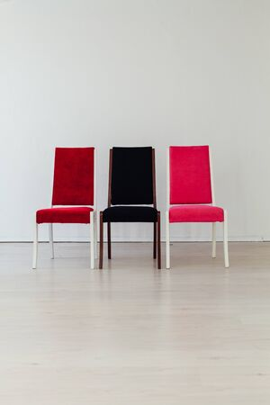 three chairs in the interior of an empty office Banco de Imagens