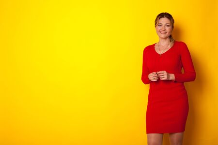 portrait of a beautiful woman of forty years in a red dress Stock Photo