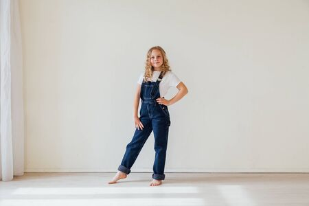 beautiful girl 10 years old in denim clothes