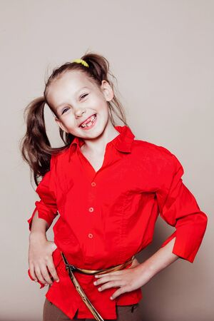 beautiful little girl with pigtails Hamming in studio