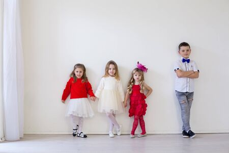 girls and boy in red and white clothes on birthday party