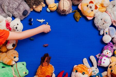 lots of baby soft toys for developing boy games on a blue background