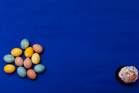 multi-colored eggs for the Easter holiday on a blue background