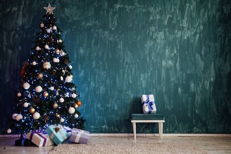 Christmas tree with gifts lights garlands new year festive background