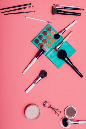 makeup artist shade powder lipstick on a pink background