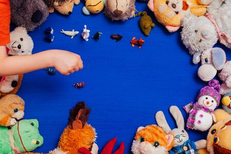 childrens soft toys for developing baby games on a blue background Stok Fotoğraf