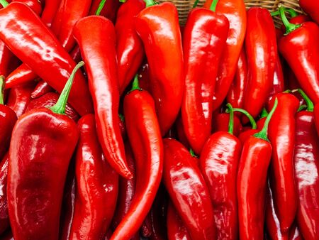 lots of ripe red hot chilli peppers for eating like a background