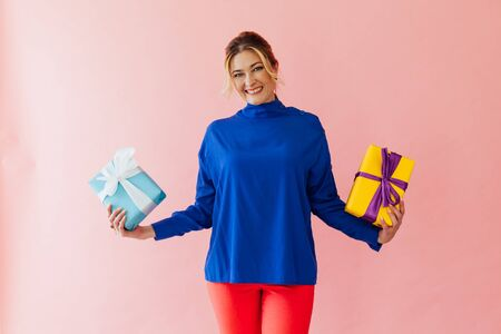 Beautiful woman holds in hands gifts for the holiday