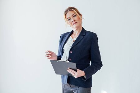 beautiful business woman holds a folder for papers