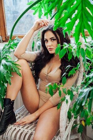 Portrait of a beautiful fashionable brunette woman in beige body shirt also Stok Fotoğraf