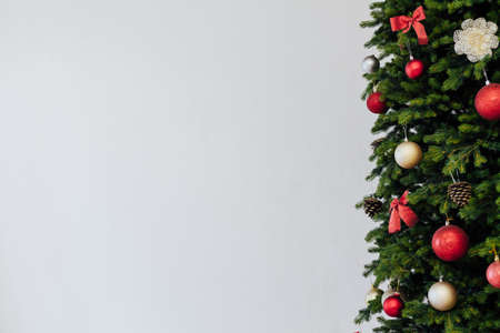 Green Christmas tree with red gifts for new year holiday decor