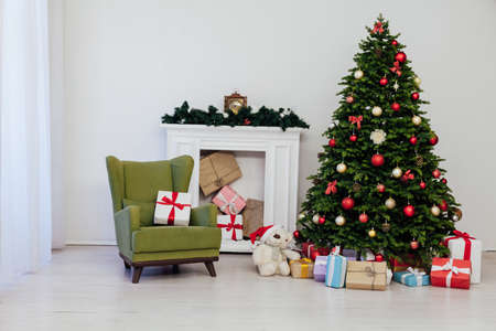 The interior of the room is a green Christmas tree with red gifts for the new year decor winter holiday