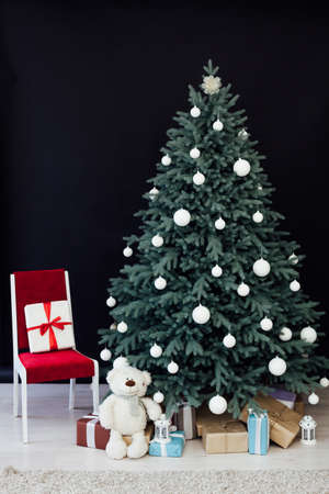 Interior with blue Christmas tree with gifts for new year decor winter postcard black background 版權商用圖片