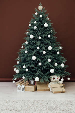 Interior with blue Christmas tree with gifts for new year decor winter postcard brown background 版權商用圖片