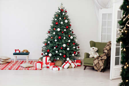 Blue Christmas tree with gifts decor for the new year winter in the white room
