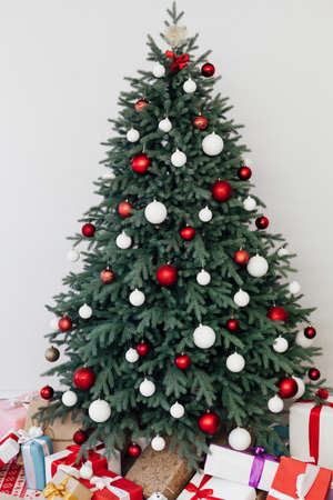 Christmas tree with gift decor for the new year winter in the white holiday card room 版權商用圖片
