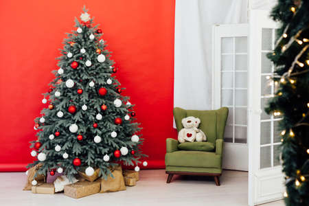 Blue Christmas tree with gift decor for the new year winter in the white postcard room holiday red background