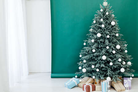Interior with blue Christmas tree with gifts for new year decor winter postcard green background Stockfoto