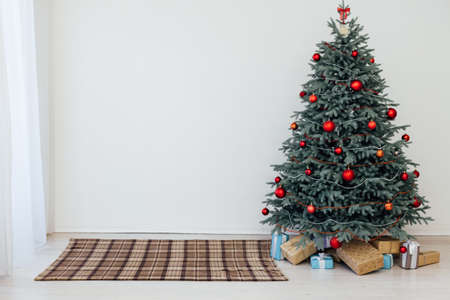 Blue Christmas tree with gift decor for the new year winter in the white postcard holiday vacation room