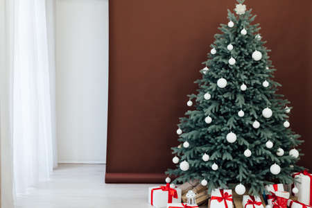 Interior with blue Christmas tree with gifts for new year decor winter brown background Фото со стока