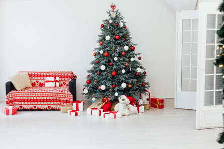 Christmas tree with red gifts decor garland for the new year winter in the white holiday card room